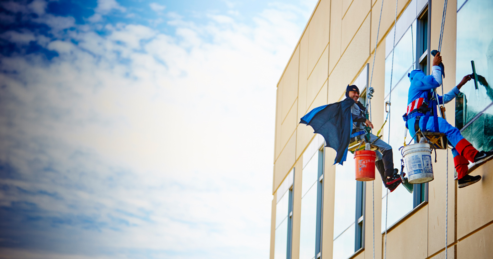 Superhero window washers working